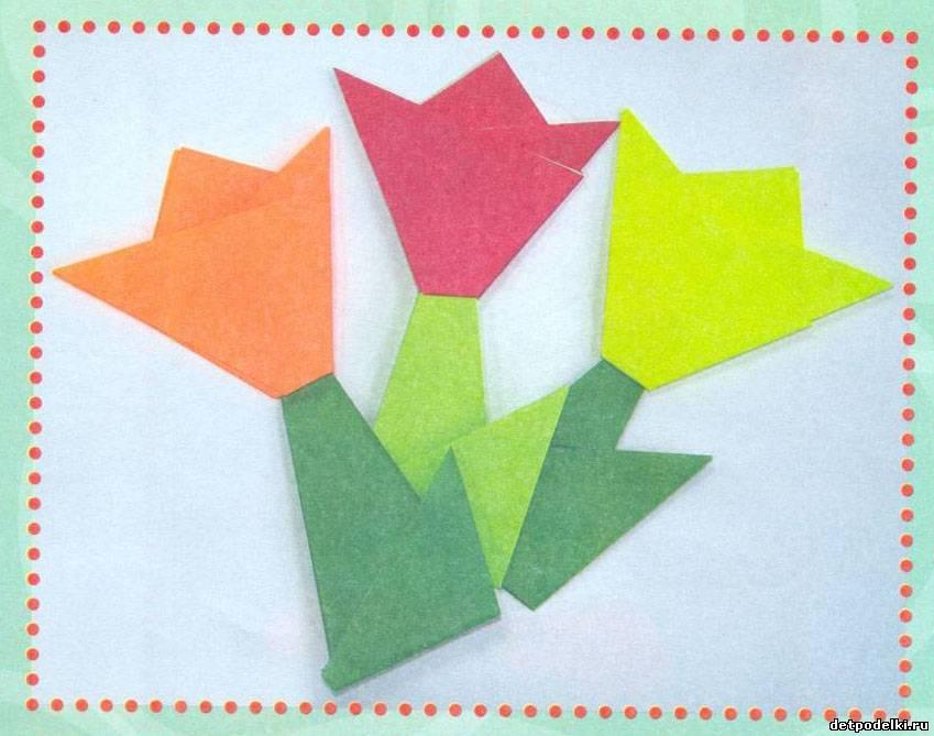 Эта поделка - цветы - простое оригами для детей.  Цветы можно приклеить на картон, обвести рамочкой и написать...
